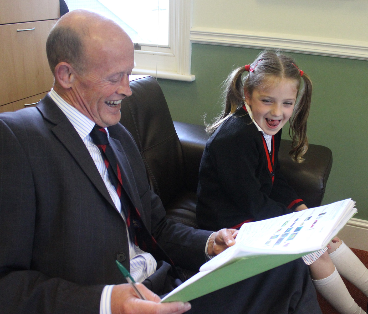 Children visit the Headmaster's Study with especially good work, recieving Headmaster's Commendations